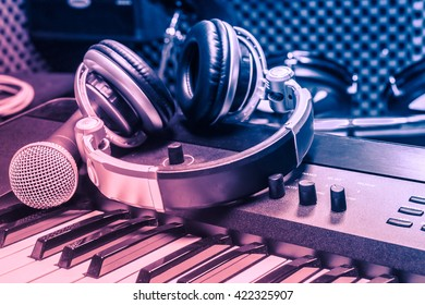 microphone,headphones on piano music background.