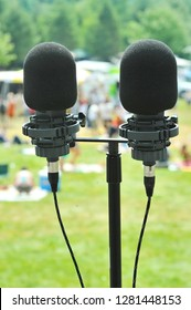 Microphones and dual mic stand on the stage at a folk music festival in upstate ny