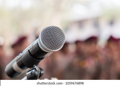 Microphones on abstract blurred of speech in seminar room, speaking conference hall light for presentation in exhibition event Background. Mic is transducer that convert sound into electrical signal.