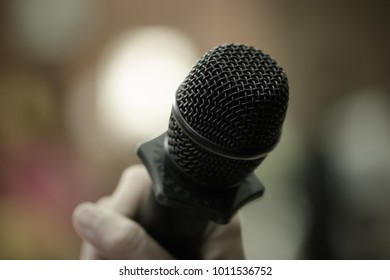 Microphones in seminar room, talking speech in conference hall light with microphone and keynote. Speech is vocalized form of communication humans, Blurred of audience in meeting room, vintage tone