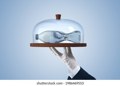 Microplastics in food concept. Microplastics and plastic pollution are global environmental problem. PET (plastic) bottle in shape of fish served on dessert stand.