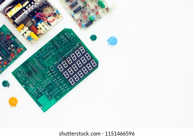 Microprocessor concept. Set of drivers, diodes, capacitors, inductance and other micro electronics on the white background. Top view. Space for a text. Close up.