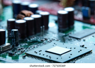 Microprocessor with motherboard background. Computer board chip circuit. Microelectronics hardware concept.