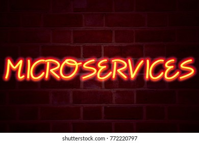 Microservices neon sign on brick wall background. Fluorescent Neon tube Sign on brickwork Business concept for Micro Services 3D rendered