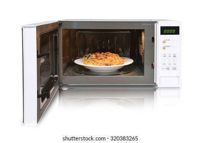 The microwave oven is warm chicken spaghetti.
