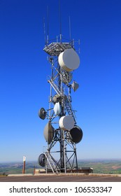 A Microwave Tower with flat parabola on a mountaintop
