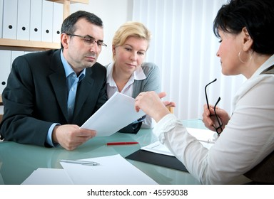 mid adult couple meeting with agent