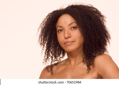 Mid adult ethnic woman of mixed racial background African-American and Latina