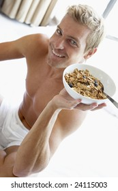 Mid Adult Man Eating A Bowl Of Cereal