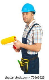 Mid adult man in jumpsuit holding paint roller isolated on white background