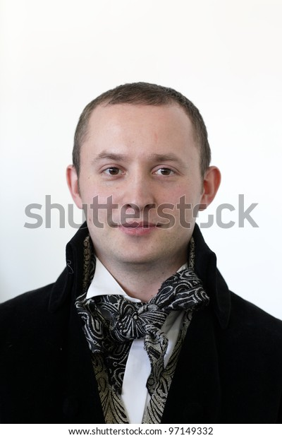 The mid adult man posing in a vintage jacket