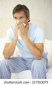 Mid adult man suffering from cold