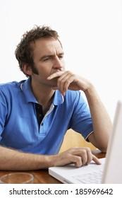 Mid adult man using laptop