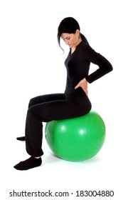Mid adult woman with a fitness ball