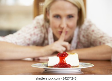 Mid Adult Woman Looking At Cheesecake