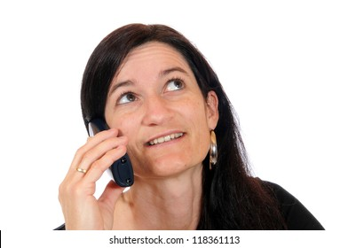 Mid adult woman making a phone call, image taken in front of a white studio background
