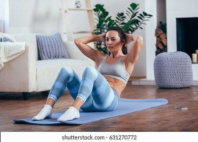 mid adult woman training abdominals at home