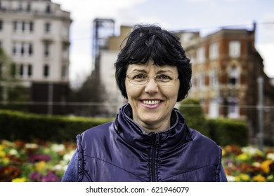 Mid age European adult woman looking to camera with smile face