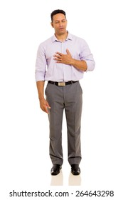 mid age man having chest pain isolated on plain background