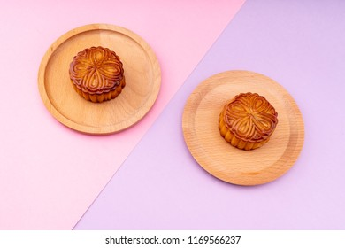 Mid Autumn Festival moon cake on pink and purple background