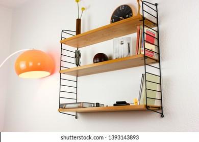mid century vintage wood book shelf  danish design 50s 60s vintage minimalistic modern hanging on the wall rack on white wall HIGH RESOLUTION