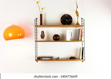 mid century vintage wood book shelf 50s 60s vintage minimalistic modern hanging on the wall rack on white wall HIGH RESOLUTION