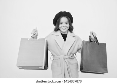 Mid season sale. Girl cute kid hold shopping bags on yellow background. Shop with discount card. Get discount shopping on birthday or holiday. Fashionista adore shopping. Obsessed with shopping.