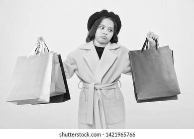 Mid season sale. Shop with discount card. Get discount shopping on birthday or holiday. Fashionista adore shopping. Girl cute kid hold shopping bags on yellow background. Obsessed with shopping.