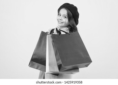 Mid season sale. Shop with discount card. Get discount shopping on birthday or holiday. Fashionista adore shopping. Obsessed with shopping. Girl cute kid hold shopping bags on yellow background.