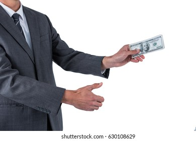 Mid section of businessman holding one hundred dollar against white background