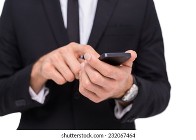 Mid section of a businessman using smartphone on white background