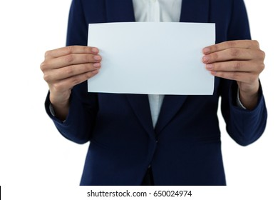 Mid section of businesswoman holding blank a paper against white background
