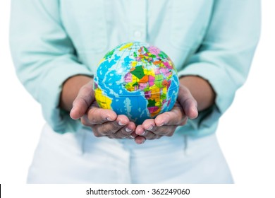 Mid section of a businesswoman holding globe against white background