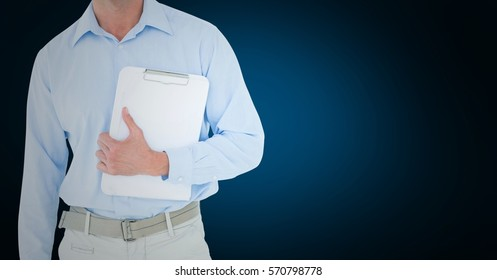 Mid section of delivery man standing with clipboard against blue background