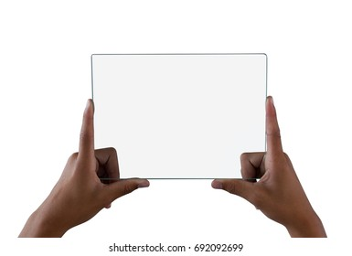 Mid section of teenage boy holding a glass digital tablet