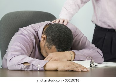 Mid section view of a businessman consoling his colleague