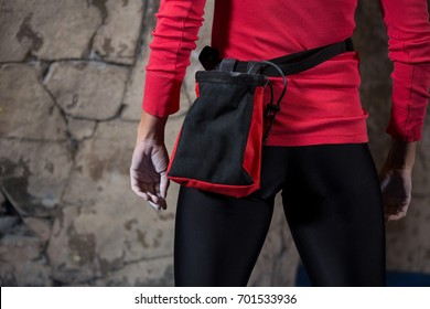 Mid section of woman standing with fanny pack in fitness studio
