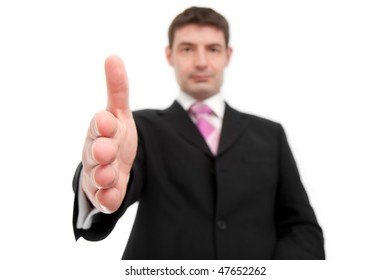 A mid thirties businessman in a black suit offers his hand in agreement.