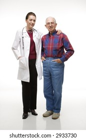 Mid-adult Caucasian female doctor with arm around elderly Caucasian male's shoulder.
