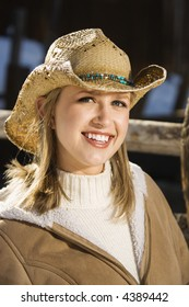Mid-adult Caucasian female wearing cowboy hat.