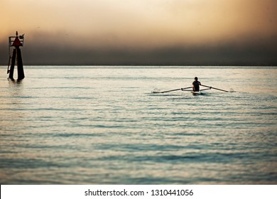 Mid-adult man sea rowing
