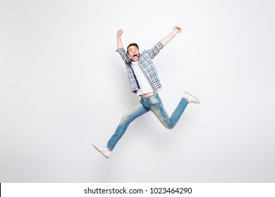 Mid-air shot of mad, crazy, cheerful, successful, lucky guy in casual outfit, jeans, shirt, with bristle, jumping with open mouth, hands up, triumphant, gesturing against white background
