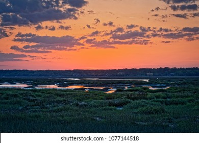 Mid-April sunset over Broad Creek on Hilton Head Island, as the tide moves back into the Creek's marshes and inlets.