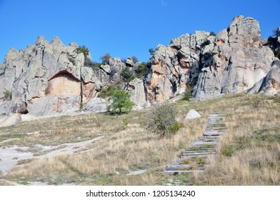 Midas Monument and wooden stairs  is located Yazılıkaya, Phrygian Yazılıkaya, or Midas Kenti (Midas city) which is Phrygian archaeological remains and inscription mentioning Midas.