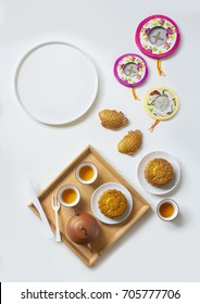 "Mid-autumn festival food and drink on white background. table top shot. Flat lay mid autumn festival image. Translation on mooncake text ""Mid-autumn""."