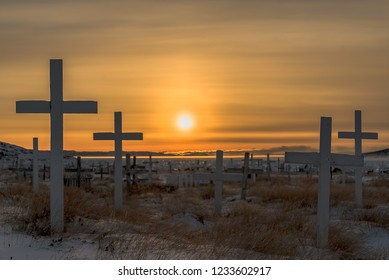 mid-day sun in November in Iqaluit, Nunavut. Looking out through the cemetary towards Frobisher Bay