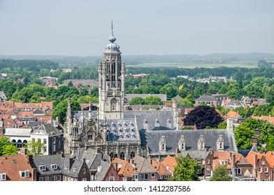 Middelburg, The Netherlands, May 30, 2019: aerial view of the city hall and its tower, built in late-gothic style around 1500, with in the background the countryside surrounding the town