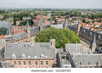Middelburg, The Netherlands, May 30, 2019: the Abdijplein (Abbey Square), its surrounding medieval buildings housing museum and provincial government, seen from the Lange Jan tower