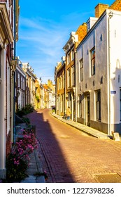 Middelburg / the Netherlands - Sept. 17, 2018: Sunset over Narrow Streets in the Historic City of Middelburg in Zeeland Province, the Netherlands