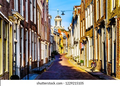 Middelburg, Zeeland / the Netherlands - Sept. 17, 2018: Sunset over Narrow Streets in the Historic City of Middelburg in Zeeland Province, the Netherlands